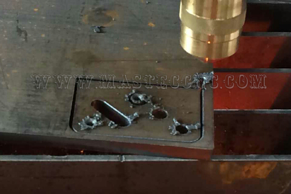 Metal cutting small hole by plasma cutter